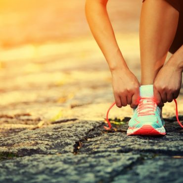 Young,Woman,Runner,Tying,Shoelaces